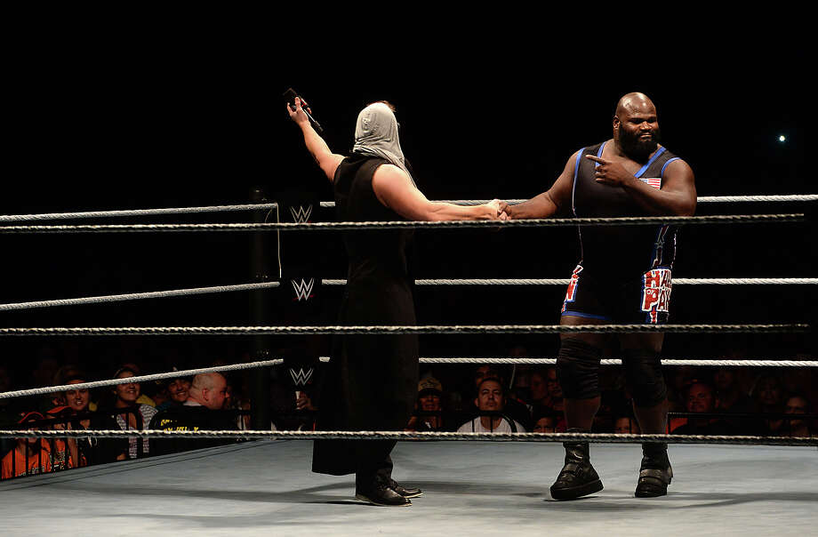 "Silsbee native and long-time professional wrestler Mark Henry, aka ""The World's Strongest Man,"" takes his turn in the ring, swiftly putting down ""The MIz,"" who poked fun at his home town, during the WWE Live show show Saturday at Ford Park. Photo taken Saturday, September 19, 2015