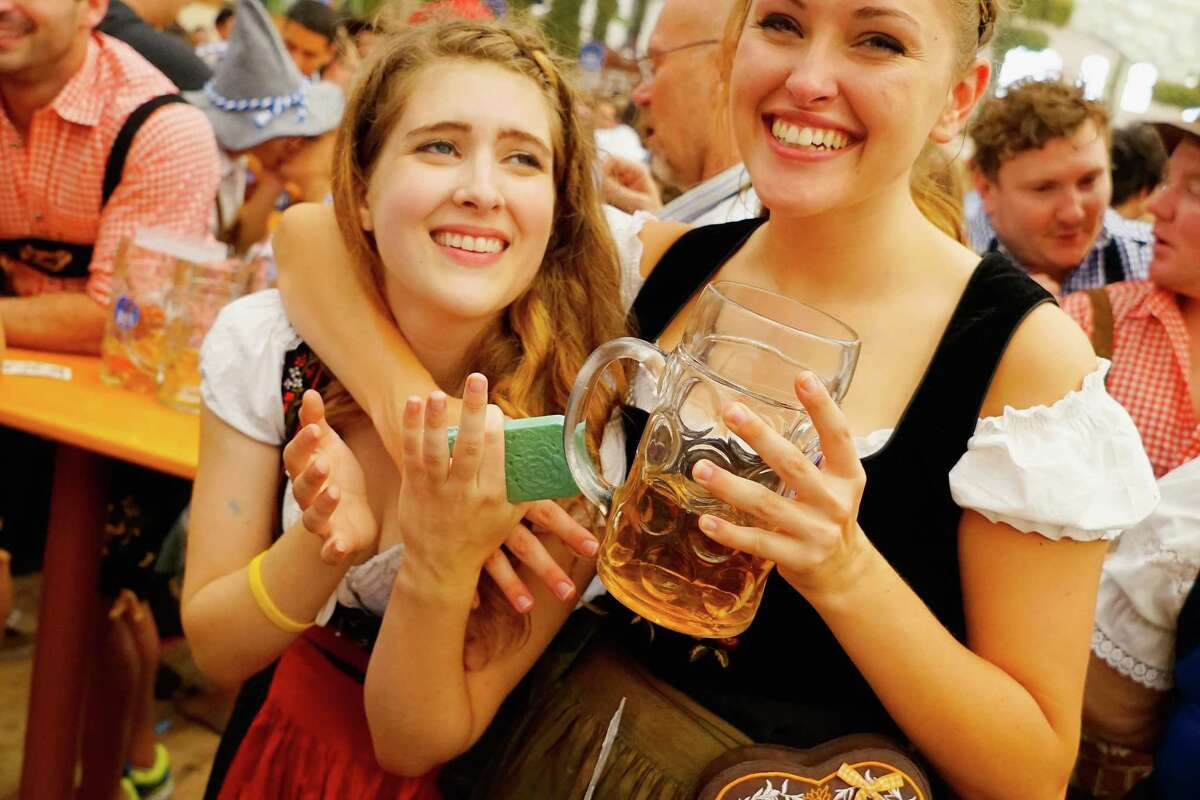 MUNICH, GERMANY - SEPTEMBER 19: Revelers enjoy drinking beer at Hofbraeuhaus beer tent on the opening day of the 2015 Oktoberfest on September 19, 2015 in Munich, Germany. The 182nd Oktoberfest will be open to the public from September 19 through October 4and will draw millions of visitors from across the globe in the world's largest beer fest..