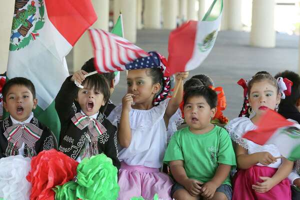 Children with Ballet Folklorico Sol de Mexico wave American and Mexican flags before the start of  the 47th Fiestas Patrias International Parade on Saturday 19, 2015 in Houston, TX.   The parade began on Texas at Jackson, and proceeded west on Texas, south on San Jacinto, east on Preston and concluded on Preston at Crawford. This International Parade is held to honor Latin American countries of Brazil, El Salvador, Costa Rica, Honduras, Guatemala, Nicaragua, Mexico, Chile, and Belize, which celebrate theirindependence during the month of September.