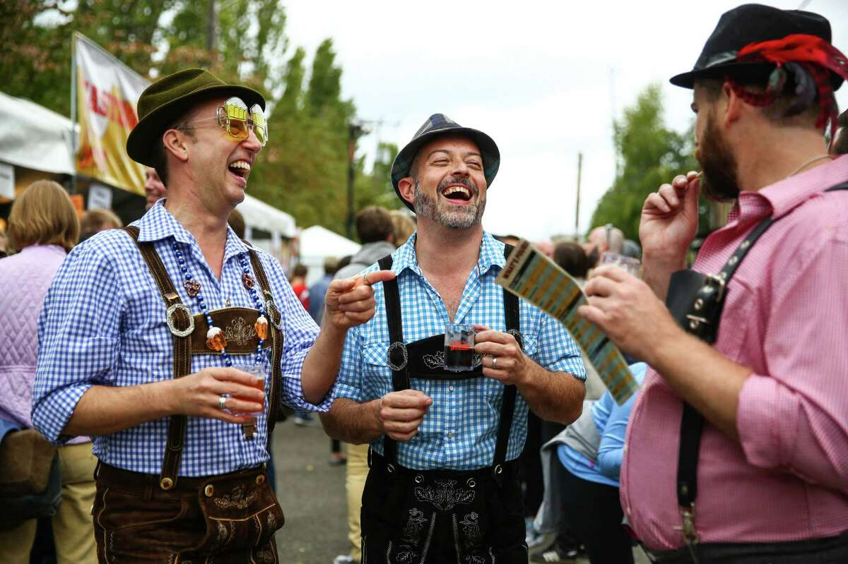 Karl Swenson, Scott Carnz and Lance Park have fun during Fremont Oktoberfest on Saturday, September 19, 2015. The annual three day event climates in a Sunday Oktoberfest 5k and chainsaw pumpkin carving contest.