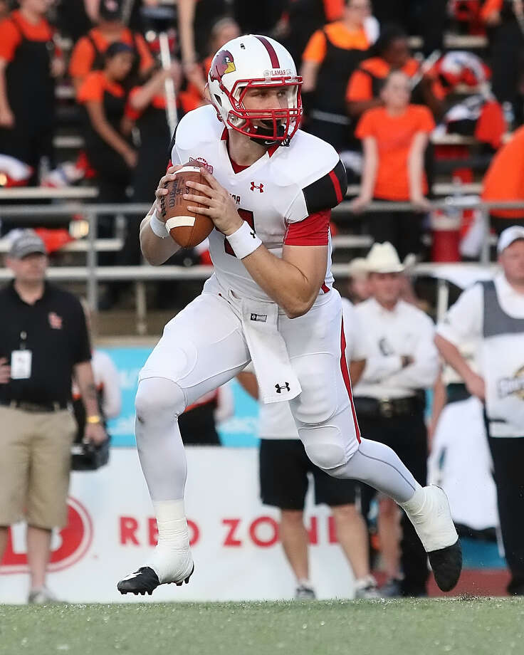Carson Earp, 11, looks to pass the ball during the game between the Lamar Cardinals and the Sam Houston State Bearkats at Bowers Stadium in Huntsville, Saturday night, September 19th, 2015 - photo provided by Kyle Ezell