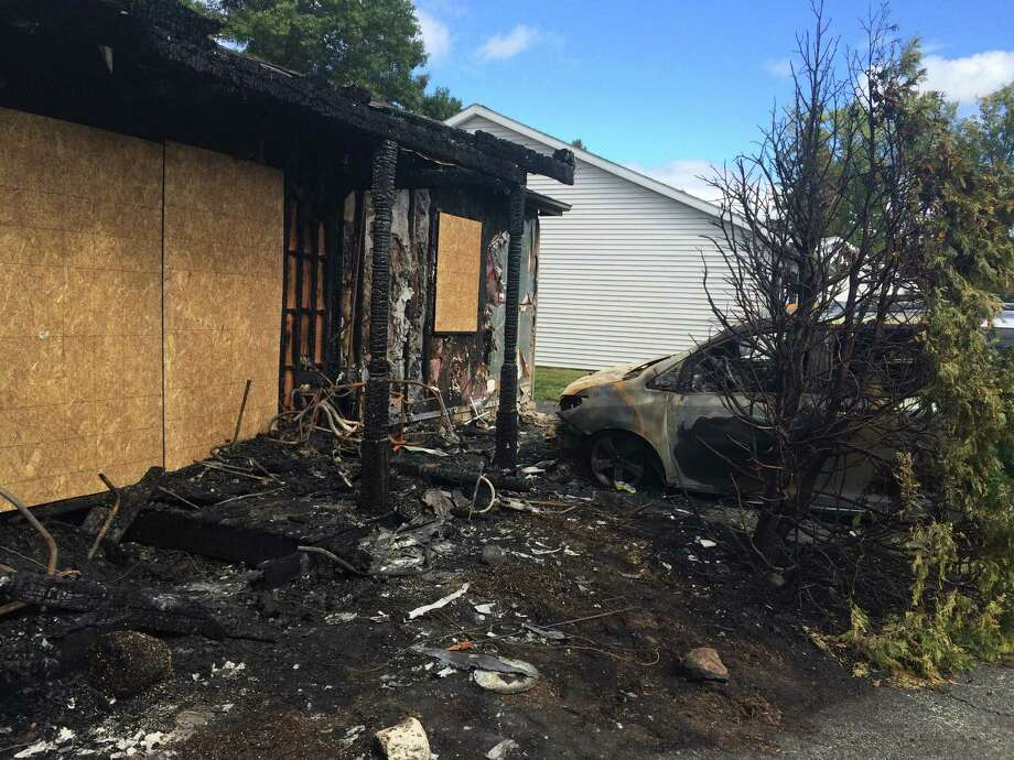 The scene of a fire on Robert Drive in the Village of Colonie Sept. 20, 2015. A family of five narrowly escaped. (Lauren Stanforth)
