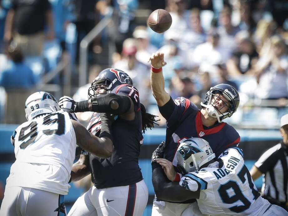 Injuries to a makeshift offensive line didn't help matters Sunday for Ryan Mallett (right) and the Texans. Photo: Brett Coomer, Houston Chronicle