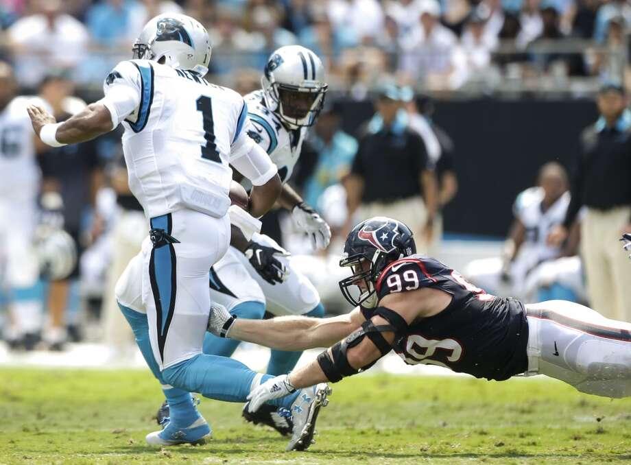 ac3587648 Texans defensive end J.J. Watt (99) and Panthers quarterback Cam Newton (1)