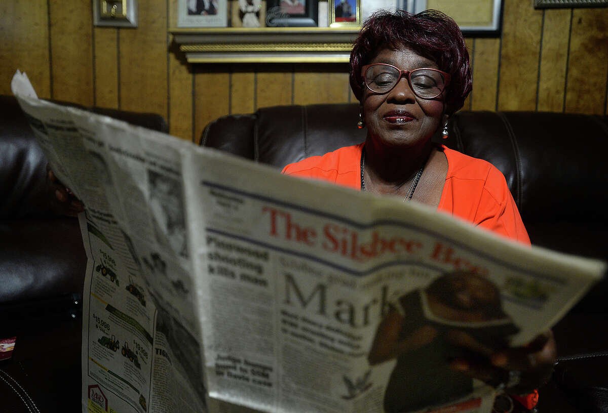 Jessie Young reads through an old article published in the local paper featuring her nephew Mark Henry as friends and family gather in her Silsbee home to talk about the Mark Henry they remember as a youth and his path to becoming an Olympic champion and long-time star of the WWE. Henry, aka