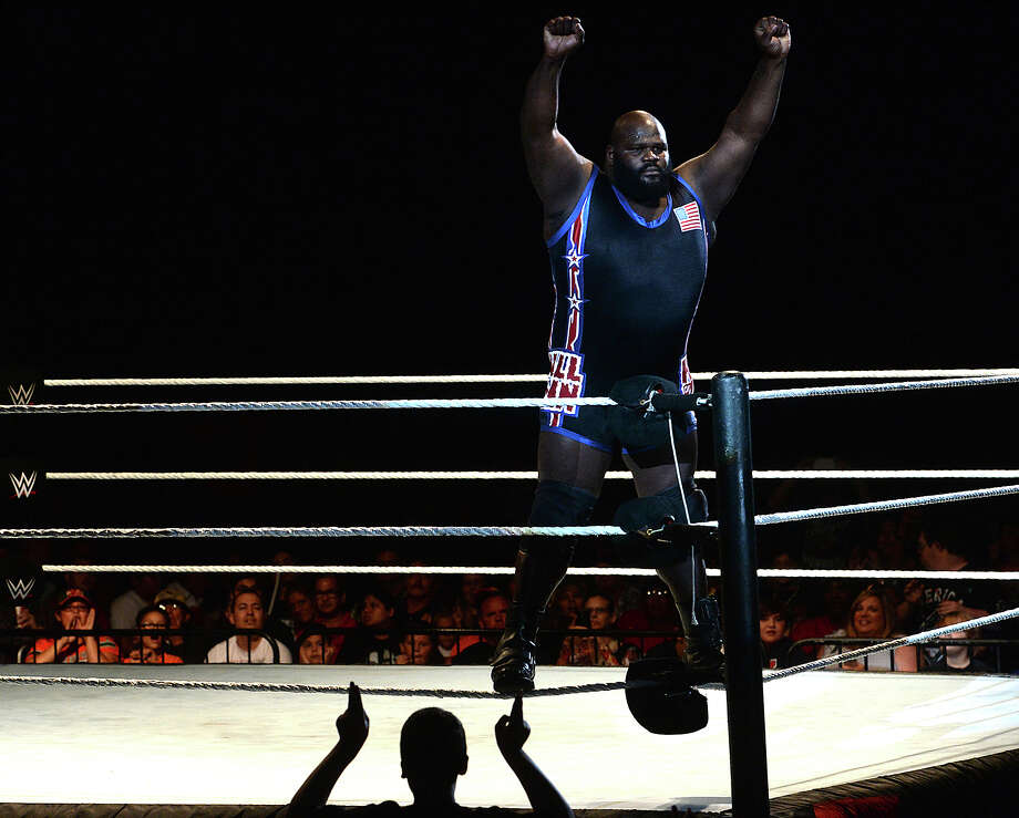 "Silsbee native and long-time professional wrestler Mark Henry, aka ""The World's Strongest Man,"" gets cheers from the crowd after making his first appearance in the ring during the WWE Live show show Saturday at Ford Park.