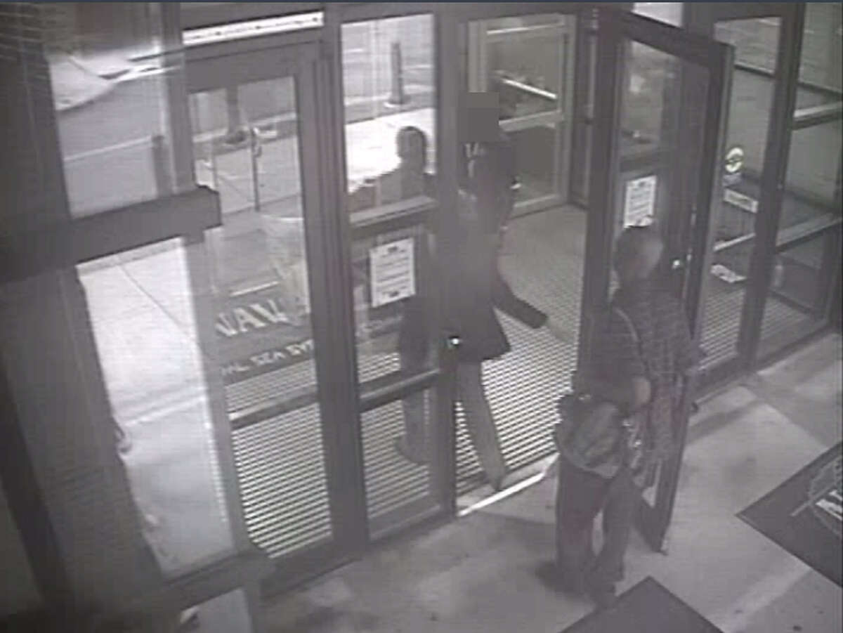 In this handout frame grab from the Washington Navy Yard provided by the FBI on September 25, 2013, Aaron Alexis enters Building #197 at 8:08 a.m., carrying a backpack September 16, 2013 in Washington, DC. Alexis had legitimate access to the Washington Navy Yard as a result of his work as a contractor, and he utilized a valid pass to gain entry to the building. The FBI investigation indicates that the gunman, Aaron Alexis, acted under the delusion that he was being controlled by extremely low frequency (ELF) electromagnetic waves when he carried out his attack on the Navy Yard, in which 12 people were killed and 4 were wounded.Latest from AP: Families file lawsuits over 2013 Navy Yard shooting