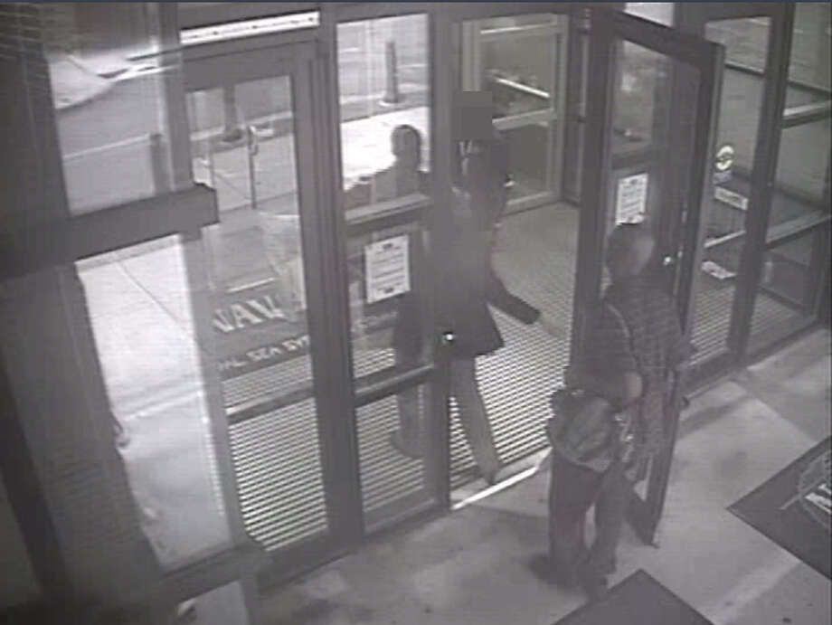 In this handout frame grab from the Washington Navy Yard provided by the FBI on September 25, 2013, Aaron Alexis enters Building #197 at 8:08 a.m., carrying a backpack September 16, 2013 in Washington, DC. Alexis had legitimate access to the Washington Navy Yard as a result of his work as a contractor, and he utilized a valid pass to gain entry to the building. The FBI investigation indicates that the gunman, Aaron Alexis, acted under the delusion that he was being controlled by extremely low frequency (ELF) electromagnetic waves when he carried out his attack on the Navy Yard, in which 12 people were killed and 4 were wounded.Latest from AP: Families file lawsuits over 2013 Navy Yard shooting Photo: Handout, Getty Images / 2013 FBI