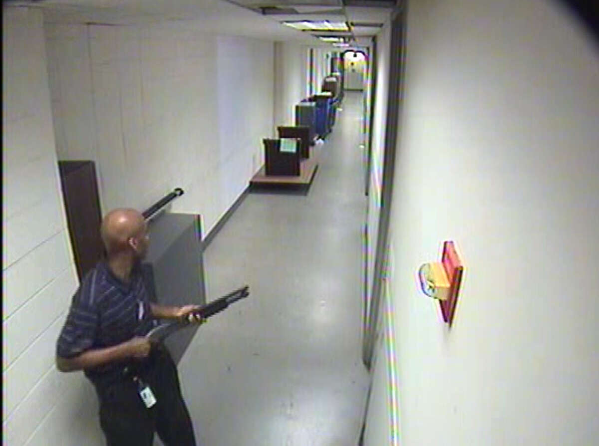 In this handout frame grab from the Washington Navy Yard provided by the FBI on September 25, 2013, Aaron Alexis moves through the hallways of Building #197 carrying the Remington 870 shotgun September 16, 2013 in Washington, DC. The FBI investigation indicates that the gunman, Aaron Alexis, acted under the delusion that he was being controlled by extremely low frequency (ELF) electromagnetic waves when he carried out his attack on the Navy Yard, in which 12 people were killed and 4 were wounded.Latest from AP: Families file lawsuits over 2013 Navy Yard shooting