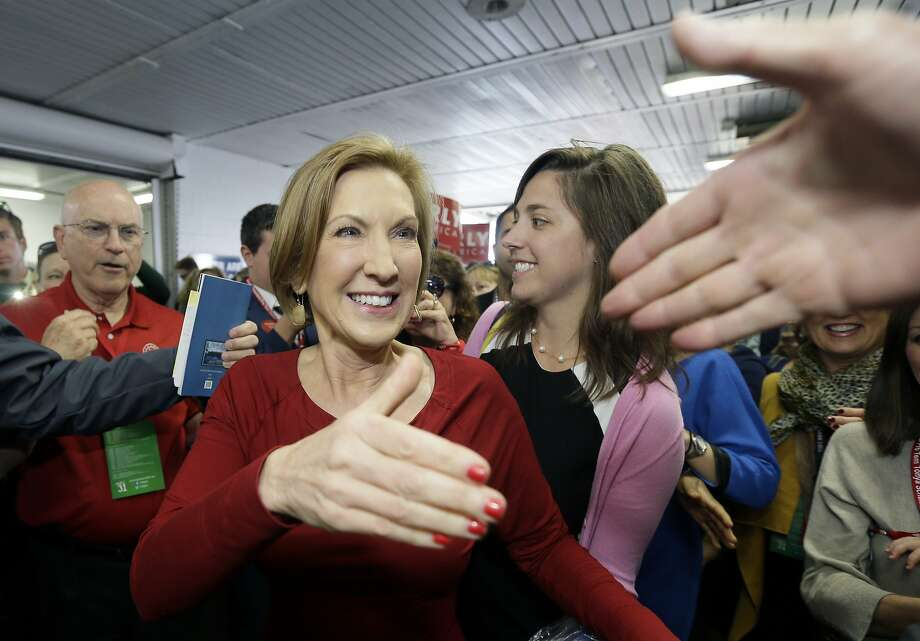 Republican presidential candidate, businesswoman Carly Fiorina greets supporters as she arrives for the 2016 Mackinac Republican Leadership Conference, Saturday, Sept. 19, 2015, in Mackinac Island, Mich. (AP Photo/Carlos Osorio) Photo: Carlos Osorio, Associated Press