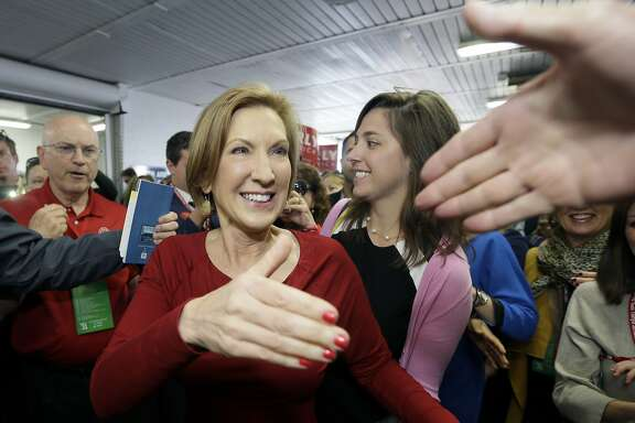 Republican presidential candidate, businesswoman Carly Fiorina greets supporters as she arrives for the 2016 Mackinac Republican Leadership Conference, Saturday, Sept. 19, 2015, in Mackinac Island, Mich. (AP Photo/Carlos Osorio)