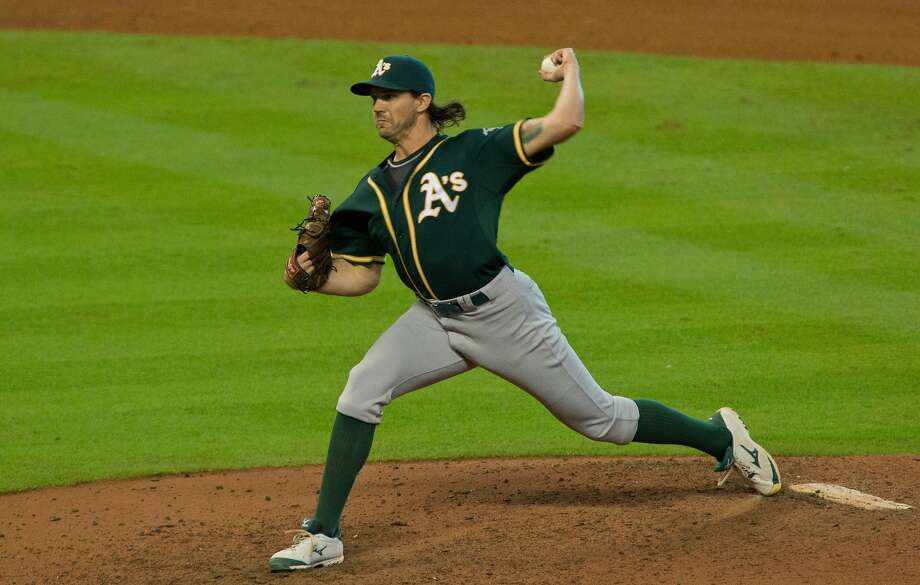 Oakland Athletics pitcher Barry Zito pitches in relief of starter Aaron Brooks to the Houston Astros in the eighth inning of a baseball game Sunday, Sept. 20, 2015, in Houston. (AP Photo/Richard Carson) Photo: Richard Carson, Associated Press