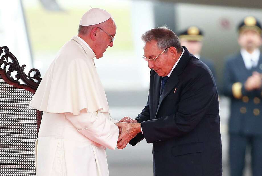 Pope Francis shakes hands with Cuba's President Raul Castro during his arrival ceremony at the airport in Havana, Cuba, Saturday, Sept. 19, 2015. Pope Francis begins a 10-day trip to Cuba and the United States on Saturday, embarking on his first trip to the onetime Cold War foes after helping to nudge forward their historic rapprochement. (Tony Gentile/POOL via AP) Photo: Tony Gentile, AP / REUTERS POOL