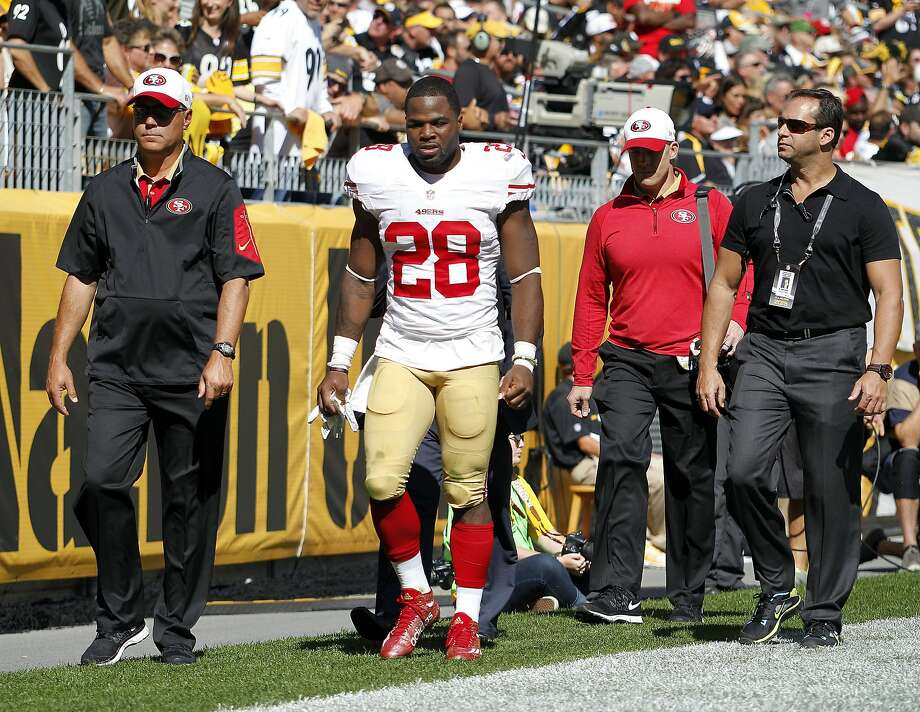 Carlos Hyde heads for the locker room to be examined after a blow to the head from Steelers linebacker Lawrence Timmons. Photo: Justin K. Aller, Getty Images
