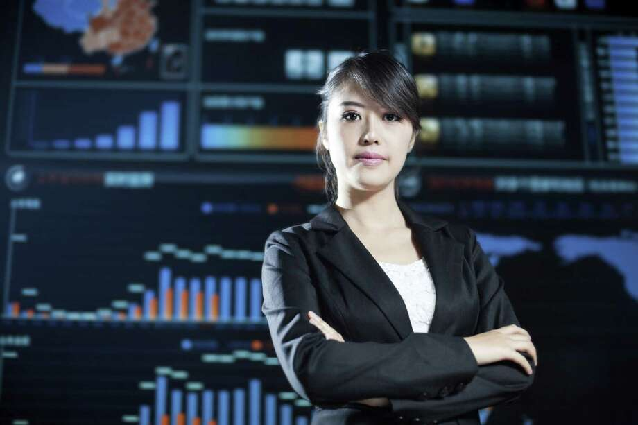 business woman in data center Photo: Loveguli, Getty Images / Vetta