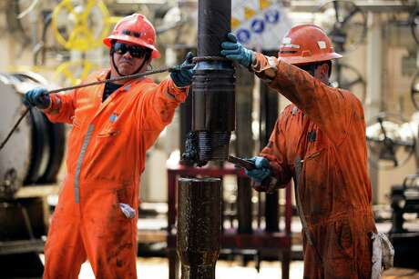 Workers change a drill pipe on the Laurus oil drilling rig operated by Pemex. For the first time since 1992, less than half of Mexico's oil exports went to the United States.