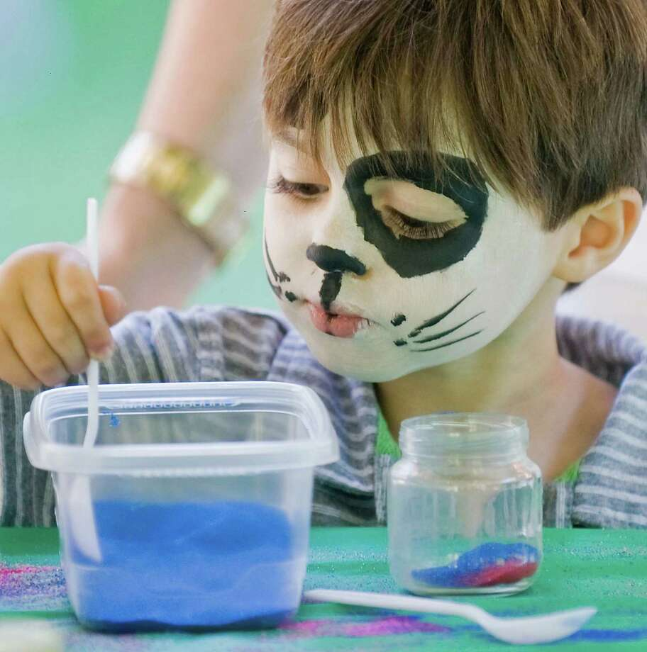 Jake Palmer, 4 of Danbury, creating sand art under the kids tent at the Culture for a Cause fundraiser held at the Ives Concert Hall at West Conn. Sunday, Sept. 20, 2015 Photo: Scott Mullin / For The / The News-Times Freelance