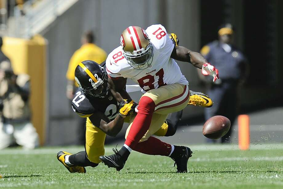 San Francisco 49ers wide receiver Anquan Boldin (81) loses the ball as he is hit by Pittsburgh Steelers cornerback William Gay (22) in the first quarter of an NFL football game, Sunday, Sept. 20, 2015 in Pittsburgh. Gay recovered that ball but replay said the pass was incomplete.(AP Photo/Keith Srakocic) Photo: Keith Srakocic, Associated Press