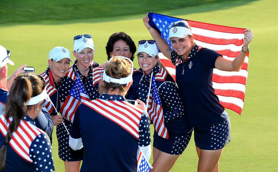 U.S. team members Cristie Kerr, Morgan Pressel, Nancy Lopez , Paula Creamer and Lexi Thompson celebrate their victory over Europe. Photo: David Cannon, Getty Images