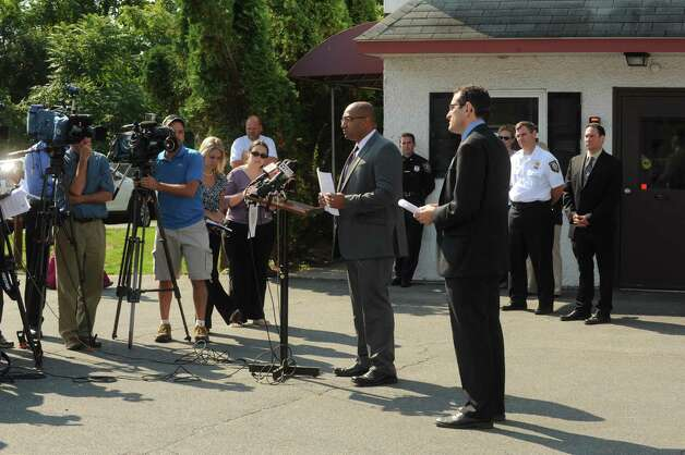 MHHS Executive Director Brad Shear, right, and Albany County DA David Soares, center, speak during a press conference announcement of a $7,000 reward by The Mohawk Hudson Humane Society, Humane Society of the United States, Albany County District Attorney?s Office and Albany Police Department ,for information leading to the arrest and conviction of the person(s) who mutilated and abandoned 3 puppies to die on railroad tracks in the City of Albany, at The Mohawk Hudson Humane Society in Menands, NY Friday Sept. 14, 2012. (Michael P. Farrell/Times Union) Photo: Michael P. Farrell / 00019261A
