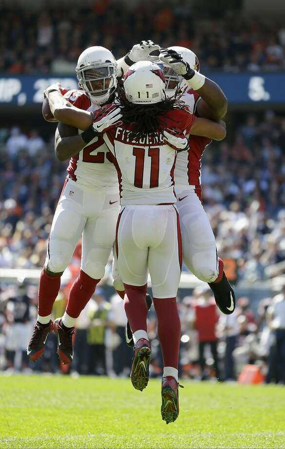Larry Fitzgerald (11) has 112 receiving yards and three touchdowns in the Cardinals' 48-23 win. Photo: Michael Conroy, Associated Press