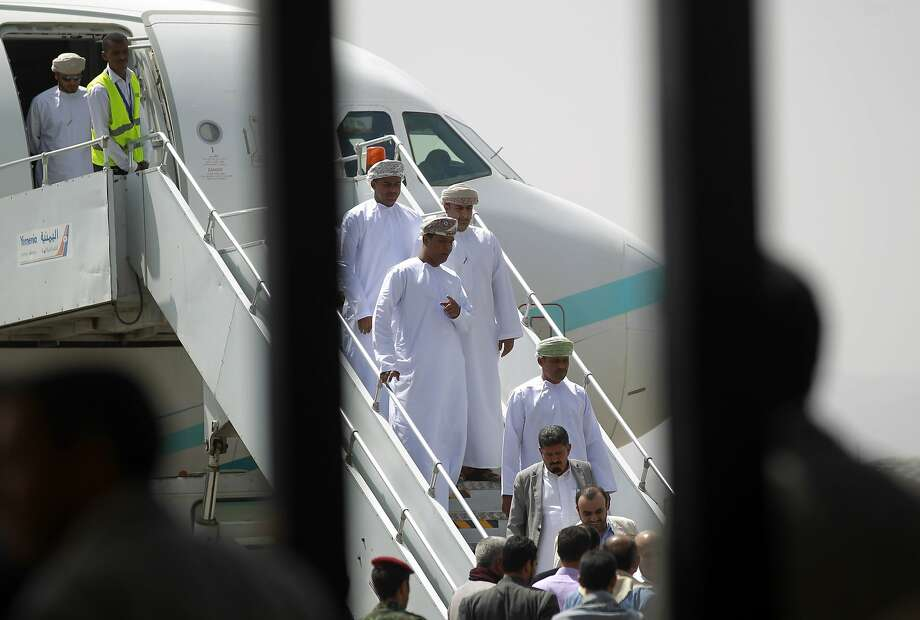 Omani government officials disembark from a Royal Air Force of Oman plane in Sanaa, Yemen. Photo: Mohammed Huwais, AFP / Getty Images