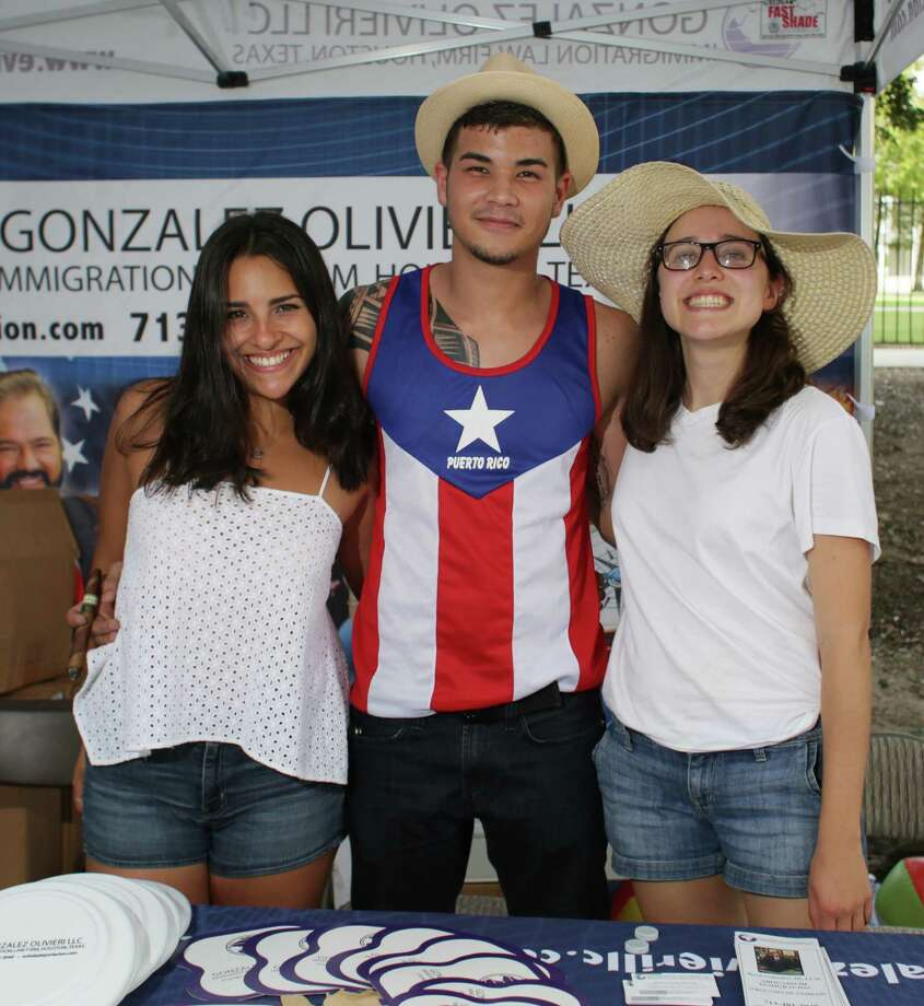 Fans pose for a photo at the annual Puerto Rican and Cuban Festival, Sunday, September 20, in Houston, Texas. Photo: Jon Shapley, Houston Chronicle / © 2015 Houston Chronicle