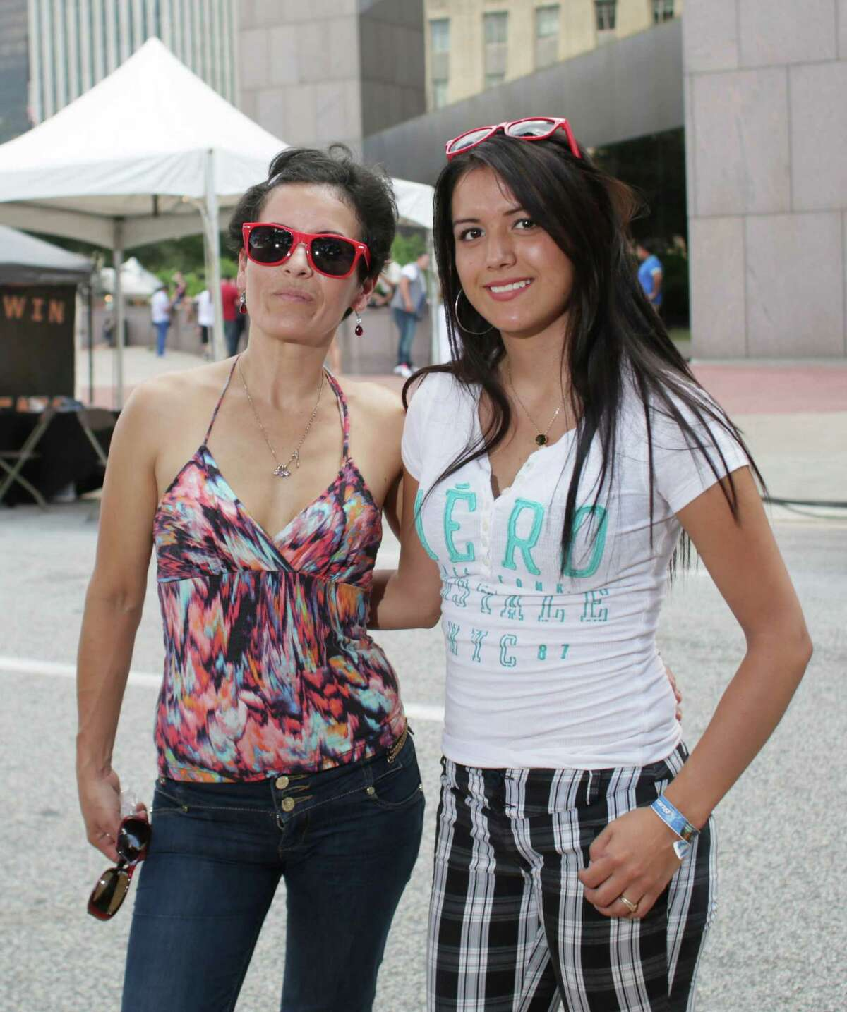 Fans pose for a photo at the annual Puerto Rican and Cuban Festival, Sunday, September 20, in Houston, Texas.