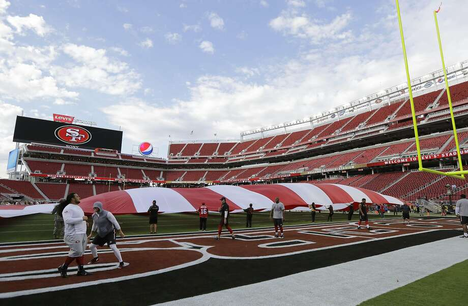 A large flag is unfurled on the field at Levi's Stadium before an NFL football game between the San Francisco 49ers and the Minnesota Vikings in Santa Clara, Calif., Monday, Sept. 14, 2015. (AP Photo/Eric Risberg) Photo: Eric Risberg, Associated Press