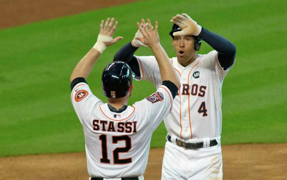 Houston Astros George Springer is greeted by teammate Max Stassi after the pair scored on Springer's two-run home run against Oakland Athletics pitcher Aaron Brooks in the fifth inning of a baseball game Sunday, Sept. 20, 2015, in Houston.  (AP Photo/Richard Carson) Photo: Richard Carson, FRE / Associated Press / FR171014 AP