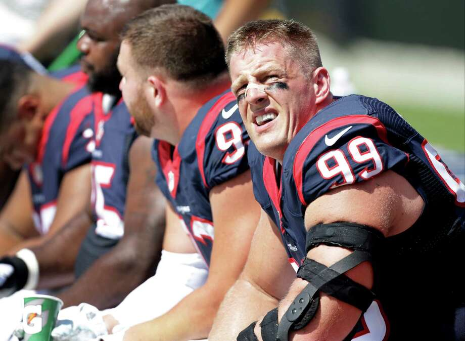 Houston Texans' J.J. Watt (99) looks up from the bench during the first half of an NFL football game against the Carolina Panthers in Charlotte, N.C., Sunday, Sept. 20, 2015. (AP Photo/Bob Leverone) Photo: Bob Leverone, FRE / Associated Press / FR170480 AP