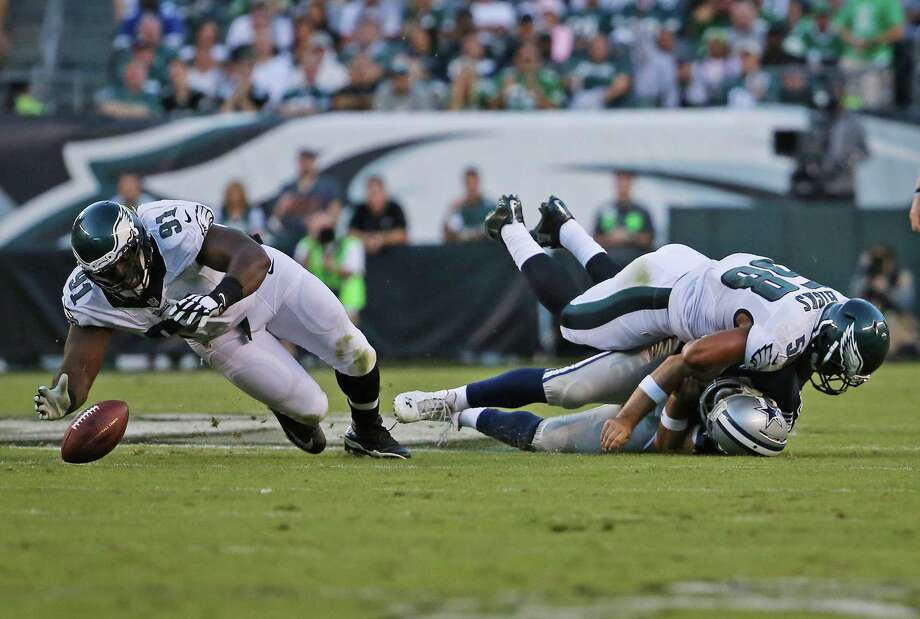 On the play that injured Dallas Cowboys quarterback Tony Romo (9), Philadelphia Eagles outside linebacker Jordan Hicks (58) hits Romo (9) as defensive end Fletcher Cox (91) leaps for the fumble during the third quarter on Sunday, Sept. 20, 2015, at Lincoln Financial Field in Philadelphia. (Paul Moseley/Fort Worth Star-Telegram/TNS) Photo: Paul Moseley, MBR / McClatchy-Tribune News Service / Fort Worth Star-Telegram