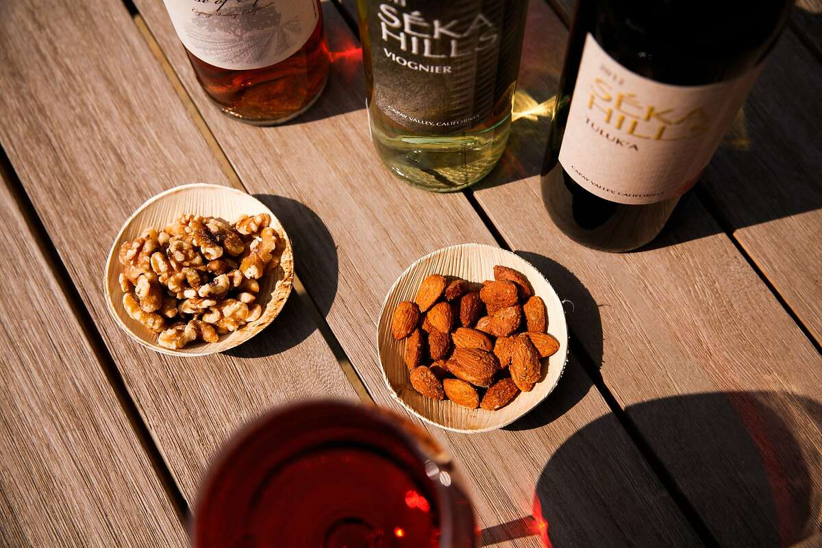 Some of the products grown and made at Seka Hills, including their garlic and herb almonds, natural walnuts, and three wines, at their tasting room in Brooks, Calif., on Tuesday, September 15, 2015.