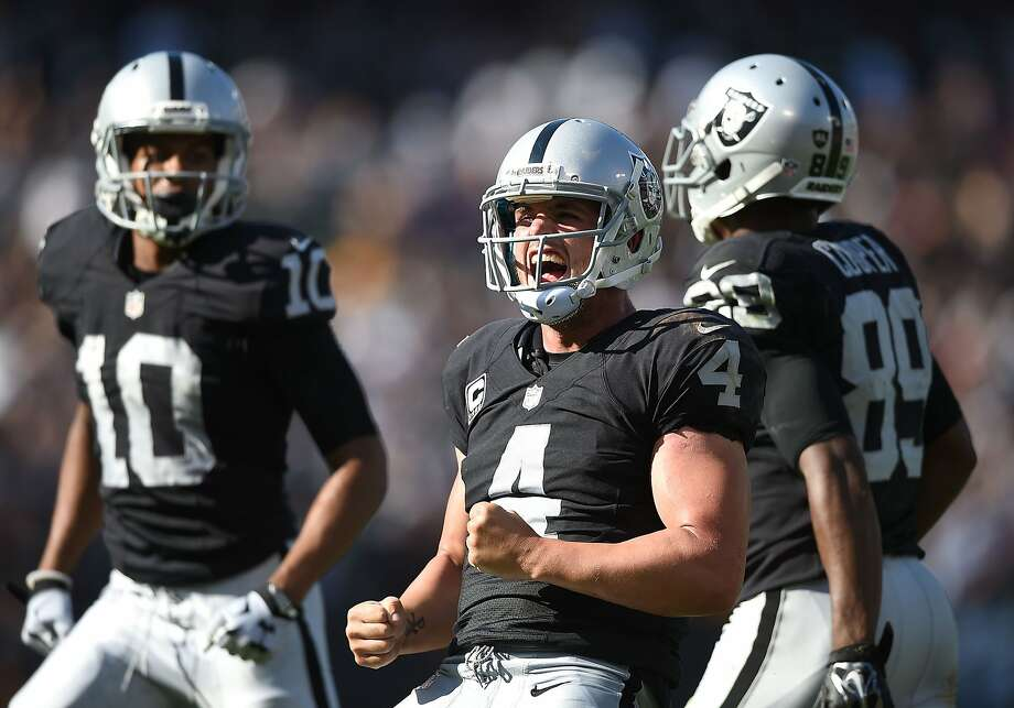 Derek Carr #4 of the Oakland Raiders celebrates the game winning touchdown in the fourth quarter against the Baltimore Ravens at Oakland-Alameda County Coliseum on September 20, 2015 in Oakland, California. Photo: Thearon W. Henderson, Getty Images