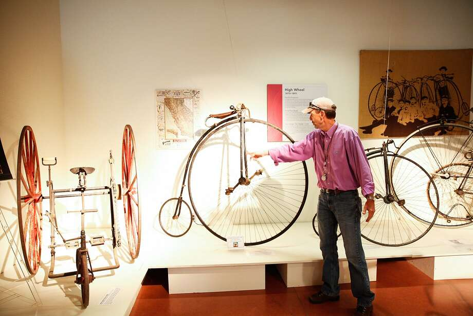 Bob Bowen, president of the U.S. Bicycling Hall of Fame, discusses the features of a penny-farthing bike on display at the group's national museum in Davis. Photo: Sarah Rice, Special To The Chronicle