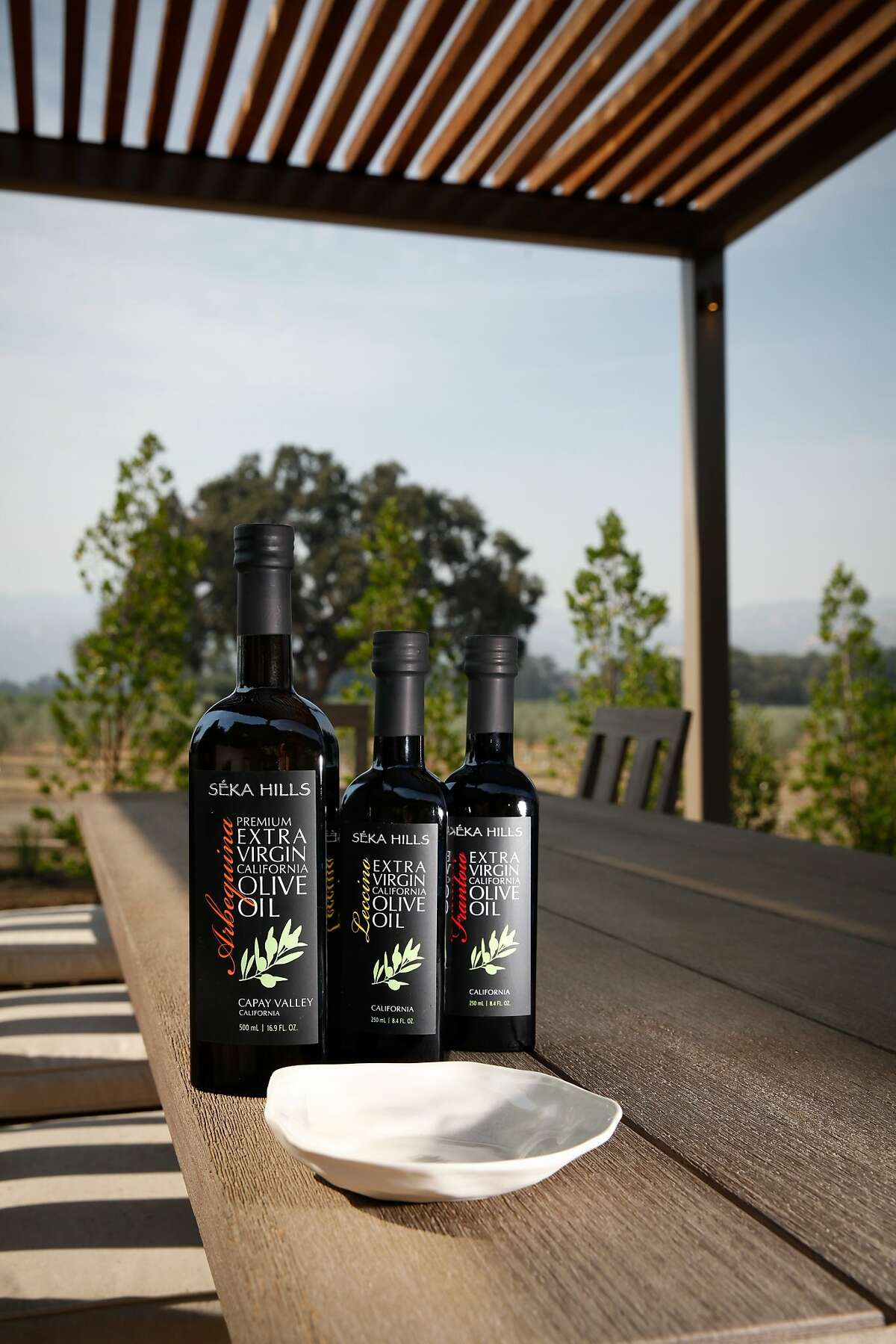 Seka Hills extra virgin olive oil, from left, premium Arbequina, the Leccino, and the Frantoio in Brooks, Calif., on Tuesday, September 15, 2015.