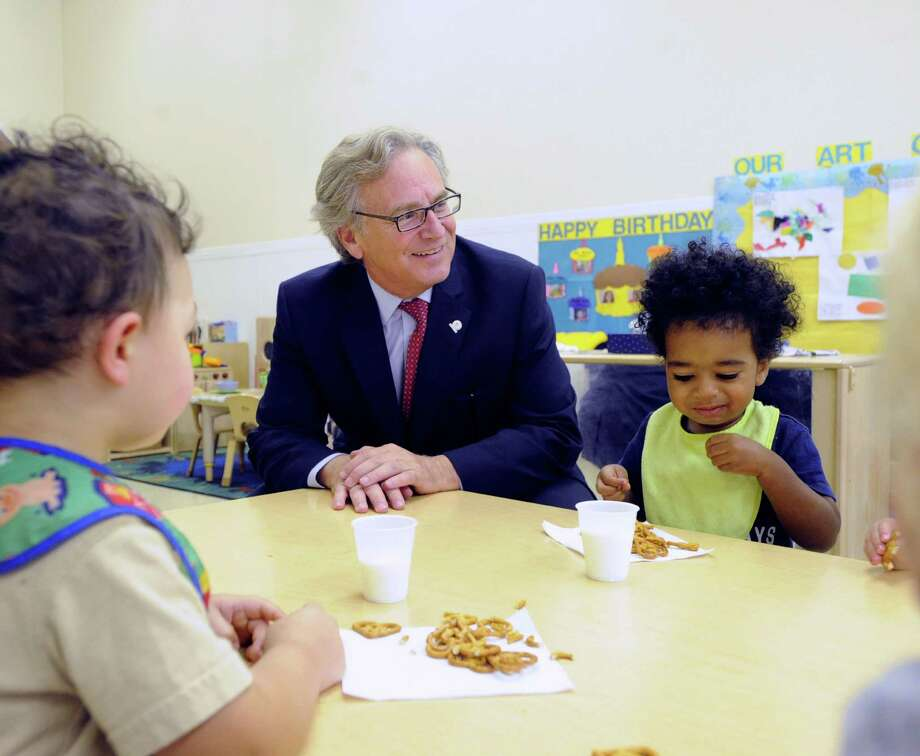 Marc Jaffe, CEO of Childcare Learning Centers, sits with children during snack time on Friday in Stamford. Photo: Bob Luckey Jr. / Hearst Connecticut Media / Greenwich Time