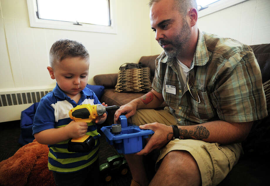 Chuck Egervari, of Seymour, plays with his son Riley, 2, at Boys and Girls Village in Milford, Conn. on Thursday, September 17, 2015. Egervari gained custody of his son after working with the organization's Reunification and Therapeutic Family Time program. Photo: Brian A. Pounds / Hearst Connecticut Media / Connecticut Post