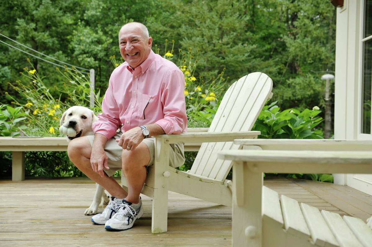 Navy, Vietnam veteran Keith Martel and his service dog Caelum outside on the deck of his home on Thursday, Sept. 10, 2015, in North Greenbush, N.Y. (Paul Buckowski / Times Union)