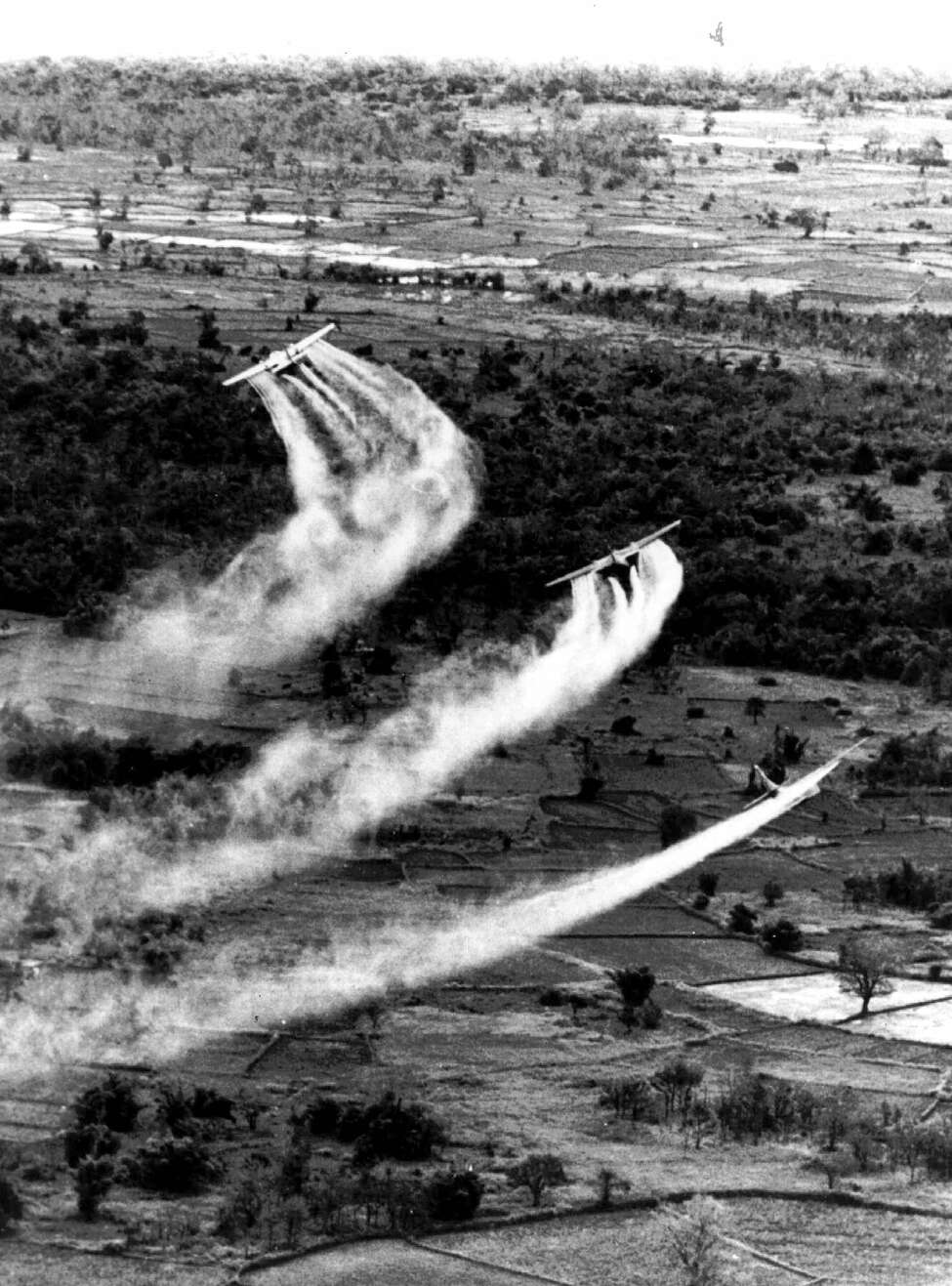 FILE--U.S. Air Force planes spray the defoliant chemical Agent Orange over dense vegetation in South Vietnam in this 1966 photo. Following a landmark conference on Agent Orange, officials from Vietnam and the U.S. agreed Sunday, March 10, 2002, to a framework for reserching the health and environmental effects of dioxin, the defoliant's toxic compound. (AP Photo)