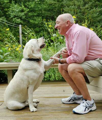 Navy, Vietnam veteran Keith Martel and his service dog Caelum outside on the deck of his home on Thursday, Sept. 10, 2015, in North Greenbush, N.Y.  (Paul Buckowski / Times Union) Photo: PAUL BUCKOWSKI / 00033276A
