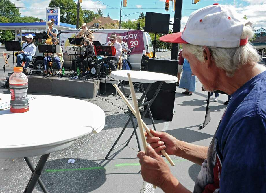 Ricky Bohl of Albany, right, drums along on a table with the band Swing Shift during the The Upper Madison Street Fair on Sunday, Sept. 20, 2015 in Albany, N.Y.  (Lori Van Buren / Times Union) Photo: Lori Van Buren / 00033283A