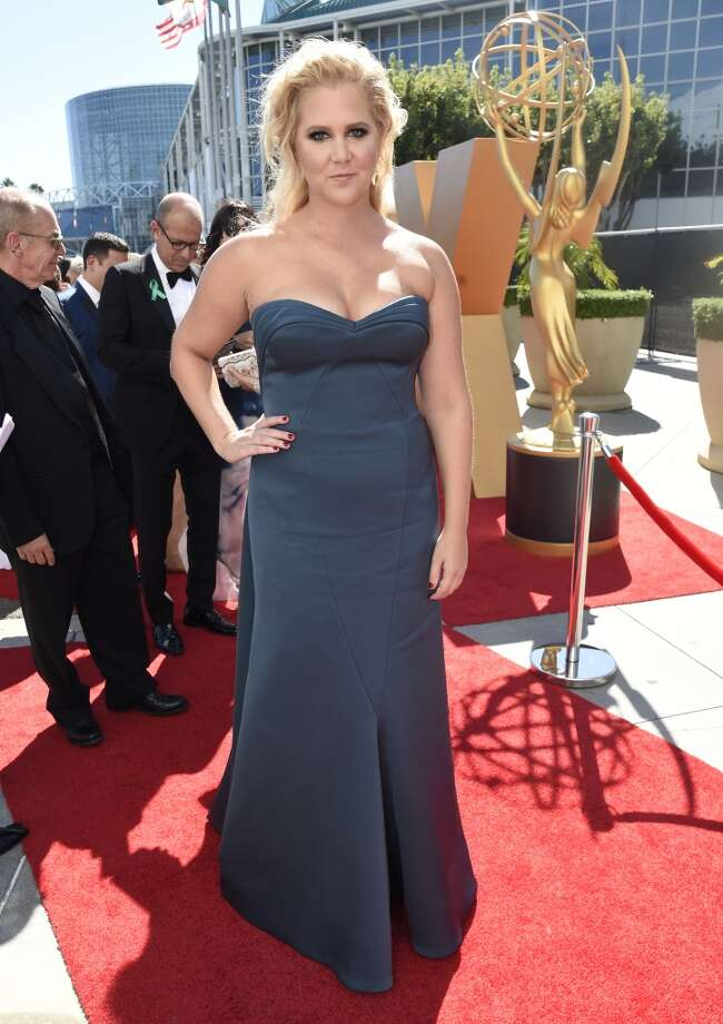 Amy Schumer arrives at the 67th Primetime Emmy Awards on Sunday, Sept. 20, 2015, at the Microsoft Theater in Los Angeles. (Photo by Dan Steinberg/Invision for the Television Academy/AP Images) Photo: Dan Steinberg, Associated Press