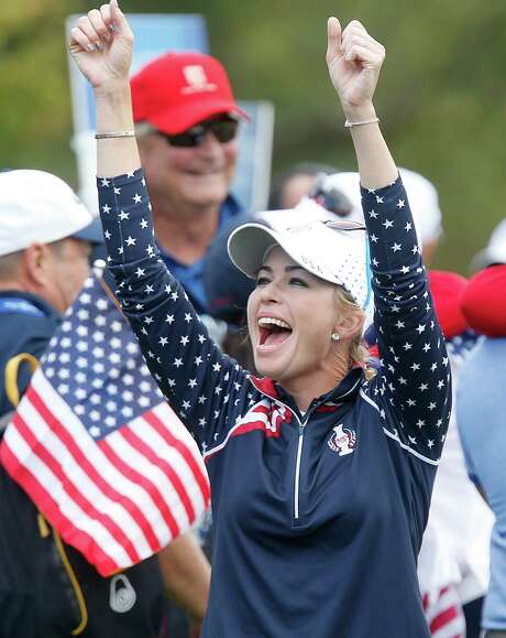 Paula Creamer celebrates after supplying the point that wrapped up the Americans' Solheim Cup win. Photo: Jens Meyer, STF / AP