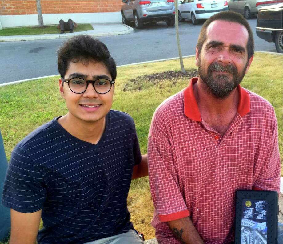"Farhan Ahmad, also a sophomore at UTSA and co-founder of VideoMed, visits with Max, a homeless man in San Antonio. ""There is a lack of continuous care"" for homeless people, Ahmad said. Photo: Courtesy /The University Of Texas /"