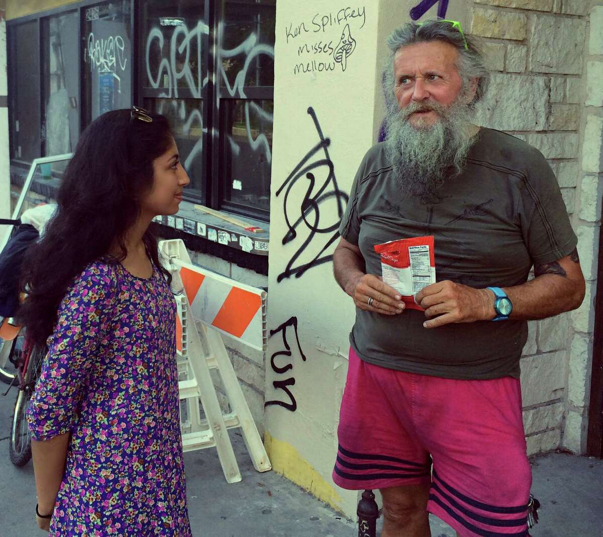 Kavina Patel, a UTSA sophomore, speaks to David, a homeless man in Austin. Patel is co-founder of VideoMed, a project to bring psychiatry services to homeless people via computer.