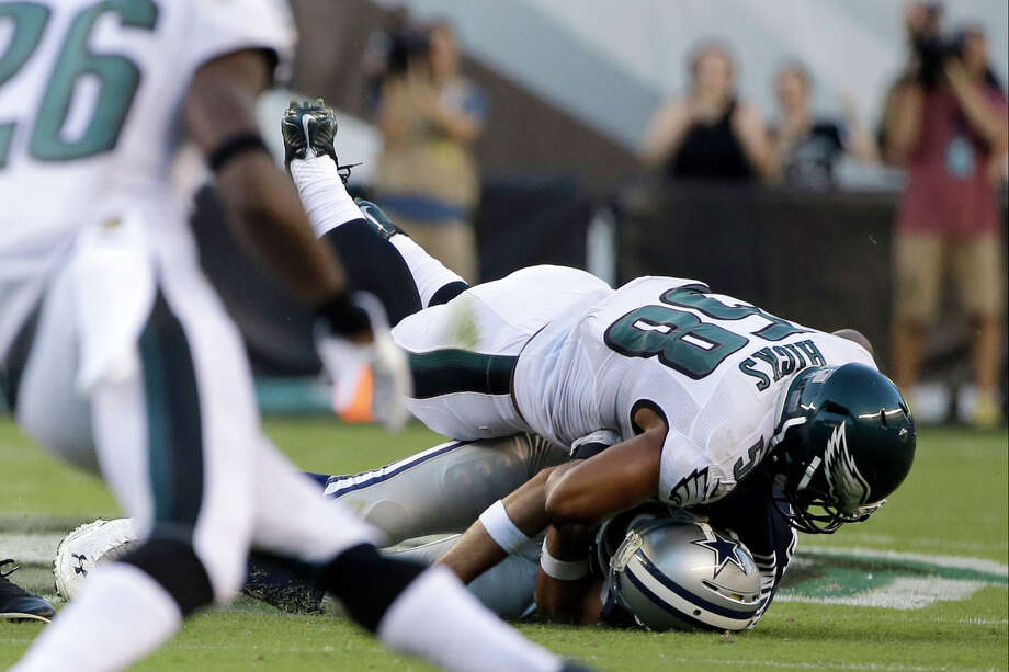 Philadelphia Eagles' Jordan Hicks (58) tackles Dallas Cowboys' Tony Romo (9) after a fumble during the second half of an NFL football game, Sunday, Sept. 20, 2015, in Philadelphia. (AP Photo/Matt Rourke) ORG XMIT: PXE123 Photo: Matt Rourke / AP