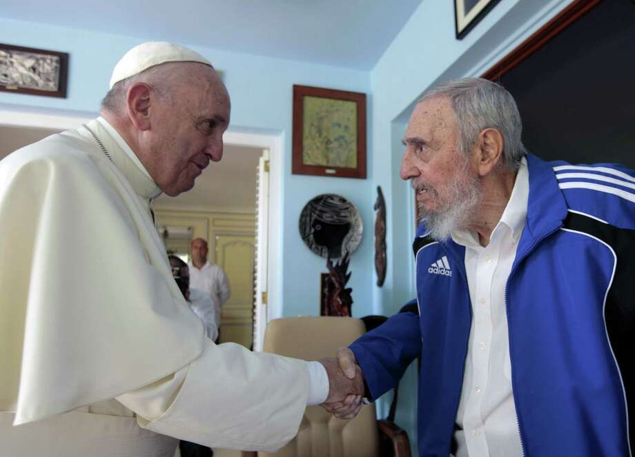 Pope Francis and Cuba's Fidel Castro shake hands, in Havana, Cuba, Sunday, Sept. 20, 2015. The Vatican described the 40-minute meeting at Castro's residence as informal and familial, with an exchange of books. (AP Photo/Alex Castro) ORG XMIT: XLAT102 Photo: Alex Castro / AP
