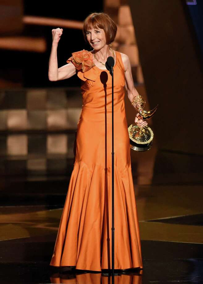 "Jane Anderson accepts the award for outstanding writing for a limited series, movie or a dramatic special for ""Olive Kitteridge"" at the 67th Primetime Emmy Awards on Sunday, Sept. 20, 2015, at the Microsoft Theater in Los Angeles. (Photo by Chris Pizzello/Invision/AP) Photo: Chris Pizzello, Chris Pizzello/Invision/AP / Invision"