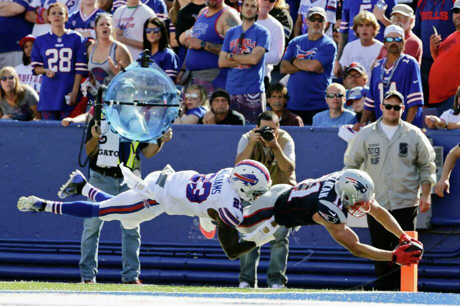 Buffalo Bills free safety Aaron Williams (23) tackles New England Patriots wide receiver Julian Edelman (11) in the end zone during the second half of an NFL football game Sunday, Sept. 20, 2015, in Orchard Park, N.Y. Williams was injured on the play as Edelman scored. (AP Photo/Bill Wippert) ORG XMIT: NYFF123 Photo: Bill Wippert / FR170745 AP